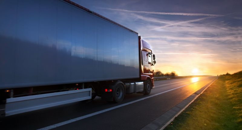 truck, trucking, road, international, white, light, speed, highway, delivery, tilt, heavy, view, shipping, line, traffic, middle, trailer, asphalt, orange, supply, freight, vehicle, automobile, transport, cargo, motion, sunset, blur, transportation, storage, way, driving, sunbeam, lorry, perspective, red, logistic, stock, clouds, transporter, high, moving, long, sky, car, industry, big, landscape, fast